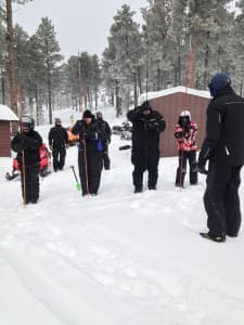 Students use probe poles in an avalanche awareness training course. Such poles are use to locate people buried beneath the snow. (Courtesy Margo Krisjansons — click to enlarge)