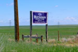 """A sign advertising Ed Buchanan's candidacy stands along a rural Wyoming Highway. Buchanan said raising $200,000 or more in the secretary of state race is """"not Wyoming style.""""(WyoFile/Gregory Nickerson — click to enlarge)"""