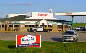 An Ed Murray campaign sign stands near a convenience store in Wheatland, Wyoming. (WyoFile/Gregory Nickerson — click to enlarge)