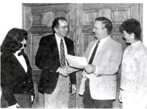 Gardetto pictured here with EWC president Guido Smith and D-Pass manager Keith Young marking the implementation of a linkage project between the two agencies. (Courtesy of Anne Gardetto - click to enlarge)