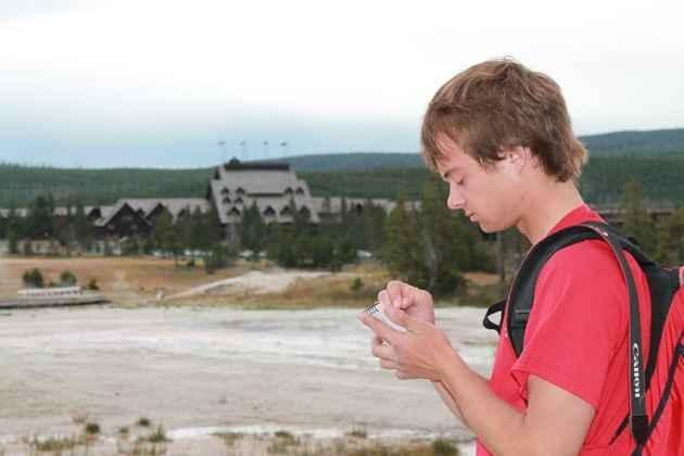 Ryan Maurer takes notes after Lion geyser erupted. (photo by Kelsey Dayton - click to enlarge)