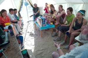The fossil-hunting crew from 2013 gathers in the cook tent for breakfast at which Rose outlines the day's work and holds forth on various topics. Often the day begins with a reading relevant to paleontology. (Angus. M. Thuermer jr./WyoFile — Click to enlarge)