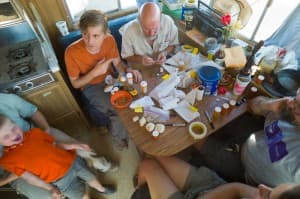 Sorting and cataloging of the day's finds takes place in a trailer that's stored in Worland over the winter. All manner of fossil hunters and their kin drop by the Johns Hopkins expedition camp during the few summer weeks the crew is camped along Fifteenmile Creek.
