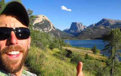 SUIndependent, a southern Utah news site, posted this photograph of Adam Stewart on its web page after the Virgin, Utah resident was killed by a bear in the Teton Wilderness. Stewart, seen here in front of iconic Squaretop Mountain at the north end of Wyoming's Wind River Range, was working for a private company conducting research for the U.S. Forest Service when he failed to return from a trip. (SUIndependent — click to enlarge)
