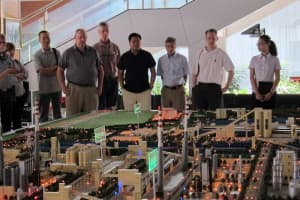 A Wyoming delegation that included four state legislators visited the Ningdong coal-to-chemical complex in the Ningxia Hui Autonomous Region in China. Here they examine a model that depicts what the complex will look like upon completion. (Dustin Bleizeffer/WyoFile — click to enlarge)