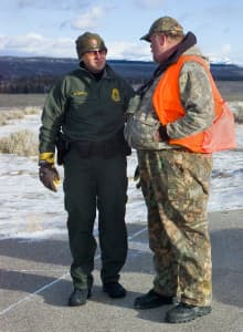 Grand Teton Ranger Ira Blitzblau talks with a hunter at Teton Point Overlook after other hunters shot a grizzly bear during the annual park elk hunt in 2012.