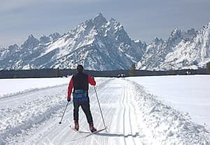 A skate skier enjoys Teton Park Road, which is groomed every Friday and on other days as time allows. (courtesy National Park Service — click to enlarge
