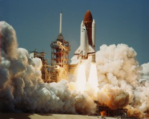 Challenger lifts off on its first flight, during a time when space flight was being seen as routine as airline travel.