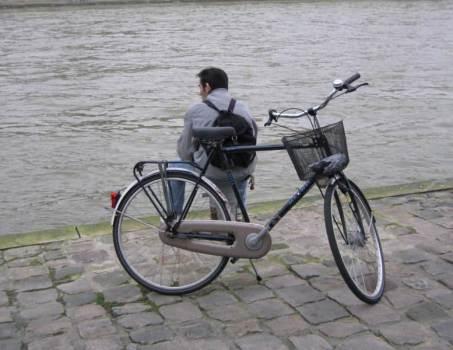 Paris City Photo - Guy watching the polluted water on Les Quais de la Seine