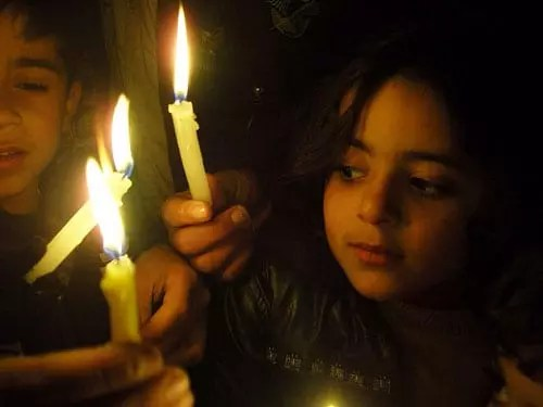 child with candle