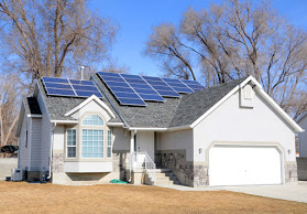 luxury house with solar panel on roof | About Us | Xcellence Inspection Services