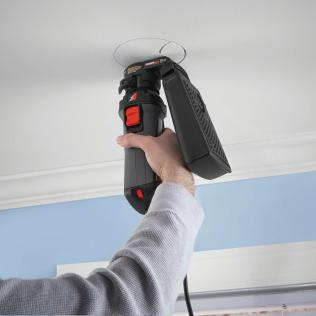 Chicago Home Inspector putting whole in the ceilings using home improvement tool