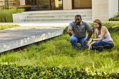 landscape contractor and homeowner in the lawn | Xcellence Inspection Services | landscape professional Chicago