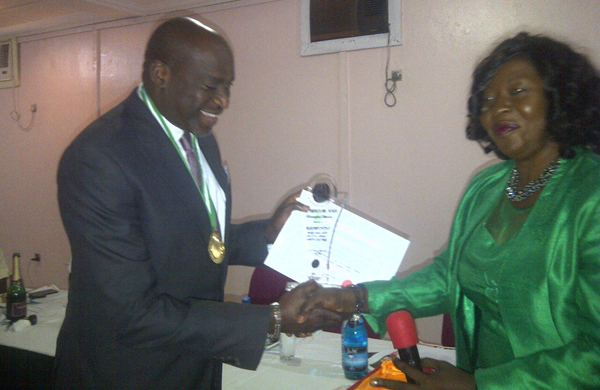Delta State Commissioner of Information, Barr. Chike Ogeah receiving his Outstanding Achievement award from Dame Minnie A. Igbrude, HPM, Oshimili South Local Government Area of Delta State