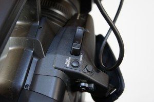 Focus Mag button on the handgrip of the PXW-Z100.