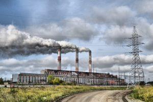 Factory and smoking chimneys