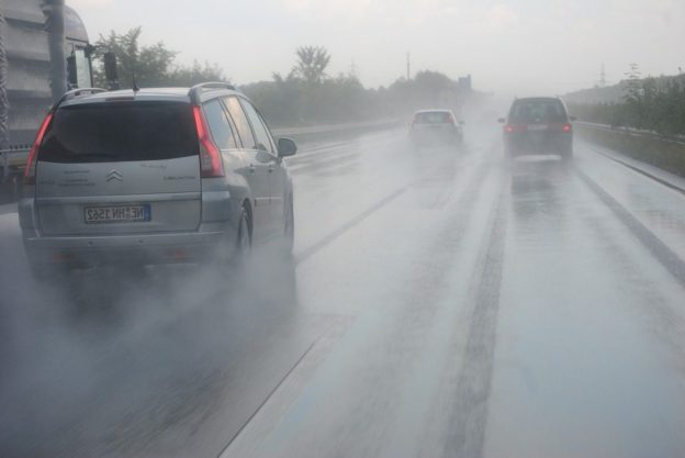 cars driving on the road while raining