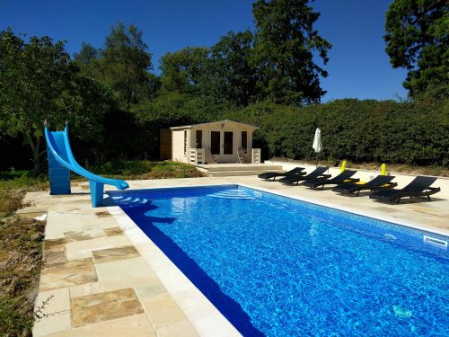 Outdoor Lined Swimming Pool With Slide and Summerhouse