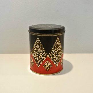 Gammel kaffedåse i sort, orange og guld