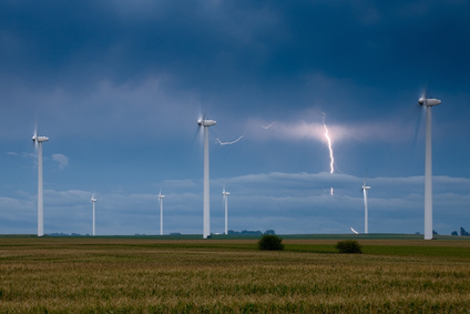 Wind turbines with a lightning bolt on the background