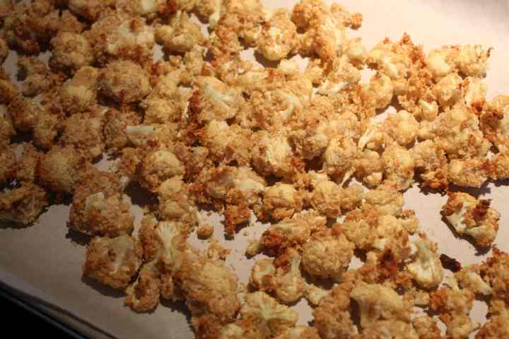 crispy baked cauliflower on a baking sheet
