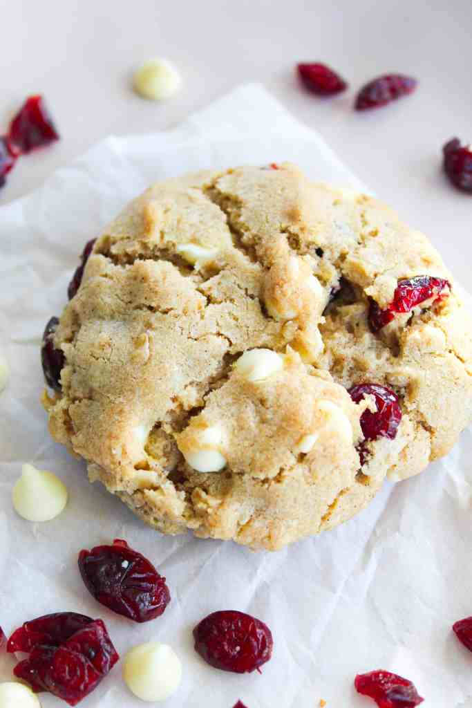 christmas cookies with oatmeal, cranberries, and white chocolate chips on a white background