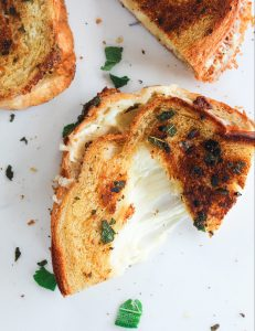 garlic sage butter grilled cheese on a white board