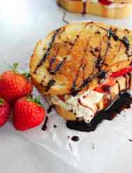 gourmet grilled cheese with mascarpone and strawberries on a white background