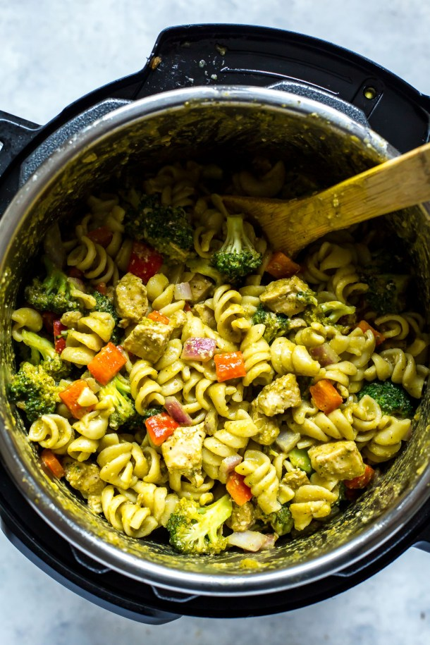 Instant Pot Chicken Pesto Pasta | Learn how to make easy pasta recipes you know and love in a one-pot wonder machine like the instant pot. These instant pot pasta recipes may seem too good to be true. With a little cleanup, you can have delicious soul-satisfying instant pot comfort food meals you can't wait to make. #xokatierosario #instantpotrecipes #instantpotpastarecipes #quickpastarecipes