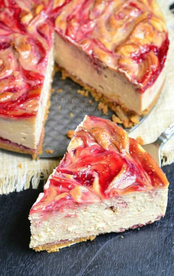 Peanut Butter and Jelly Cheesecake | Learn how these creative peanut butter and jelly recipes go beyond the classic sandwich. Choose from Peanut Butter and Jelly Cheesecake or Donuts to PB & J Muffins or Hand Pies. These peanut butter and jelly recipes make lovely desserts, snacks or anytime treats that you and your family will totally love! #xokatierosario #peanutbutterandjelly #pbjdesserts #easypb&jdesserts