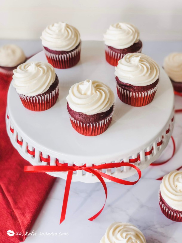 Red velvet cupcakes are a popular flavor that's rich flavor and bright, vibrant color. Learn how these home baking tips and tricks are going to make cake decorating easier. Homemade Red Velvet cupcakes are so much more than dyed chocolate or vanilla cake. This cupcake recipe is made from scratch and is full of flavor. #xokatierosario #redvelvetcupcakes #homemaderedvelvet #redvelvetcreamcheese
