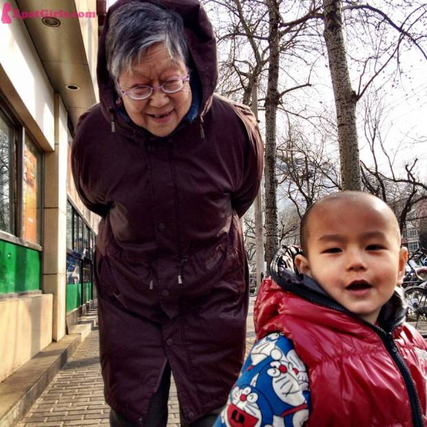Grandmother taking care of her grandchild during the week