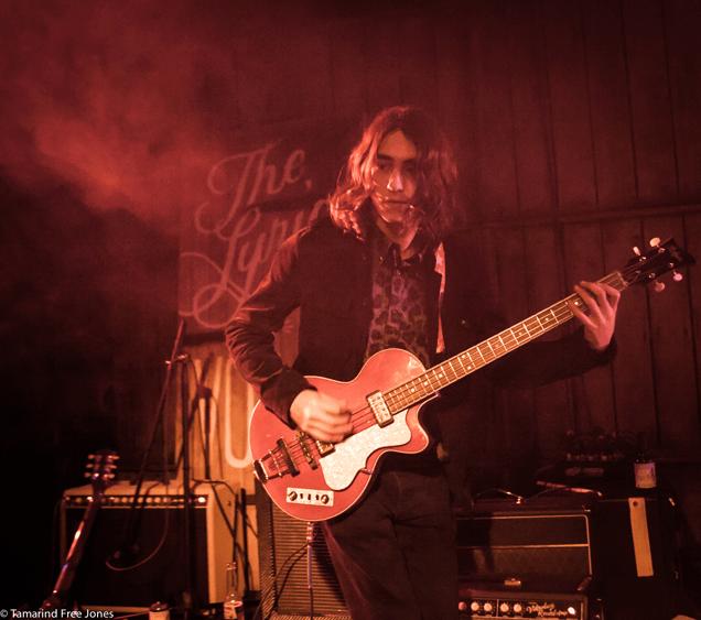 Josh Lewis on guitar