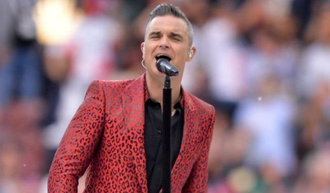 ROBBIE WILLIAMS' biggest hit 'Angels' is about him communicating with spirits as a child
