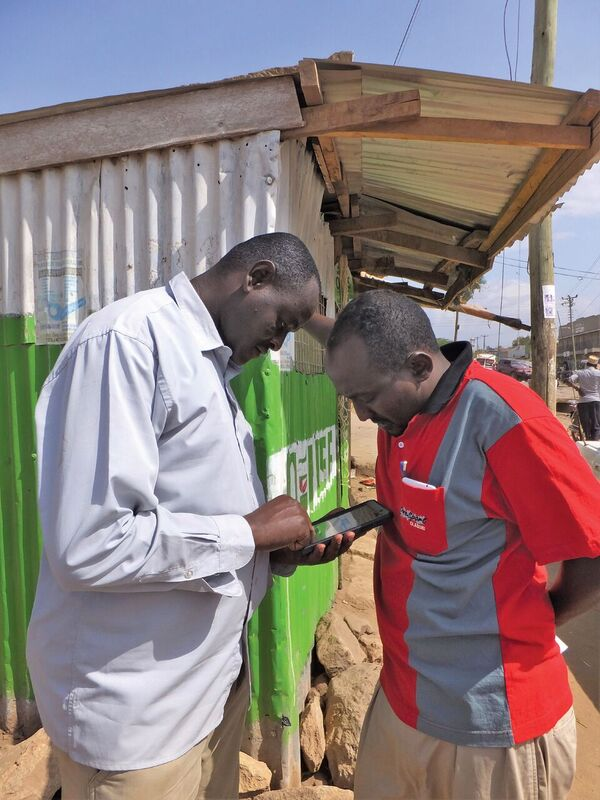 Liban Golicha of Kivulini Trust, an NGO in Northern Kenya, works with a community leader to map and record evidence of pastorlists' land claims in Northern Kenya. Credit: Marena Brinkhurst, Namati.