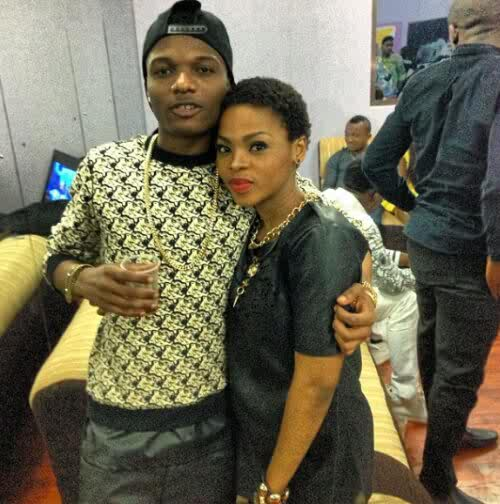 Wizkid and Chidinma strikes a pose together