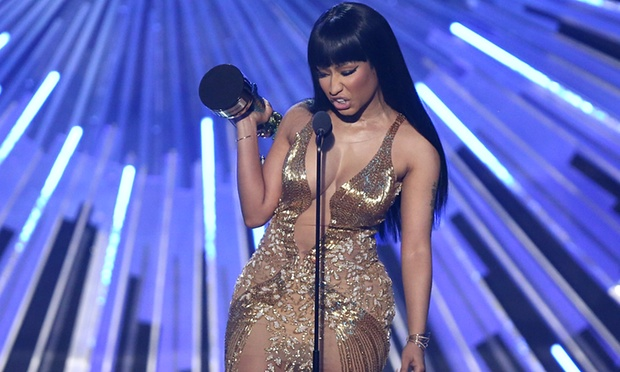 """Nicki Minaj accepts the award for hip-hop video of the year for """"Anaconda. She used her acceptance speech to attack MTV awards host Mile Cyrus. Photograph: Matt Sayles/Invision/AP"""
