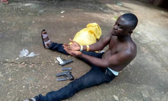 Photo: Man Caught At Obudu Motor Park With Pistols And Magazines Buried In A Bag Of Garri