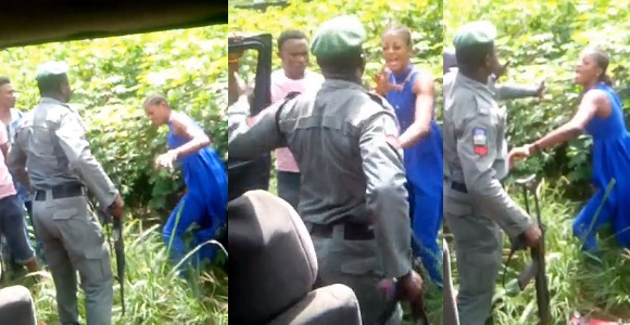 Nigerian policeman captured on camera beating a lady for refusing to allow him check her bag