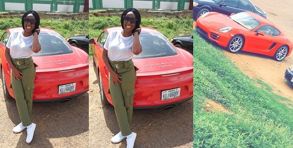 Female Corps member steps out with a Porsche for clearance in Abuja
