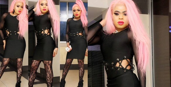 Nigerian shemale, Bobrisky flaunts his curves in sexy black dress.