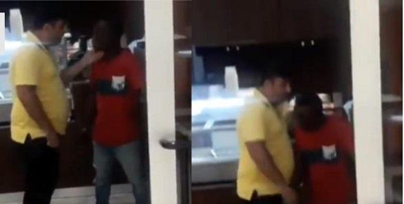 Policeman slaps man