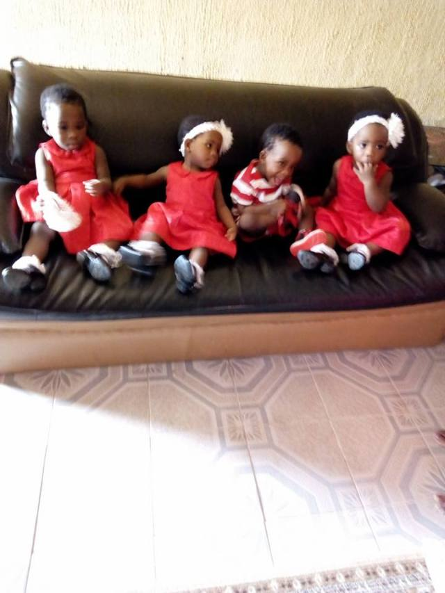Woman celebrates quadruplets