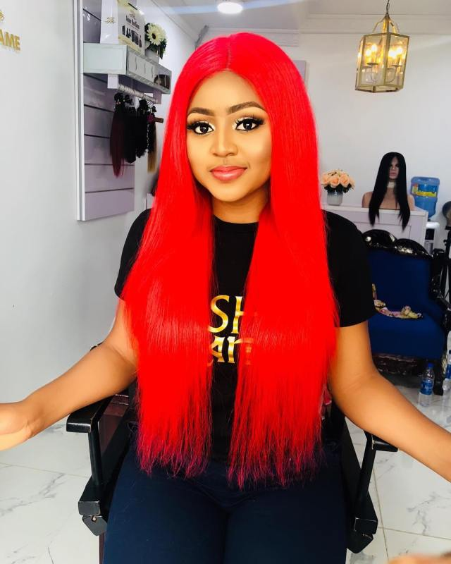 Teen actress, Regina Daniels flaunts new look, rocks the red weave.