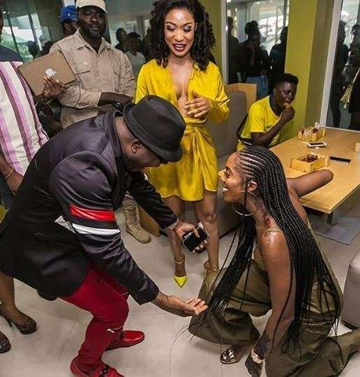 Sir Shina Peters reacts after Tiwa Savage knelt down to greet him