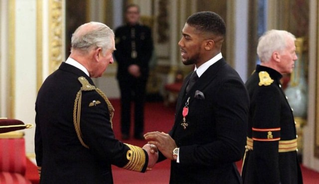 Anthony Joshua awarded OBE by Prince Charles for services to Sport (photos)