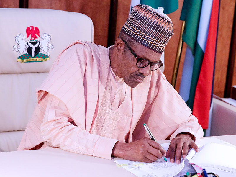 President Buhari signs N30,000 minimum wage bill into law