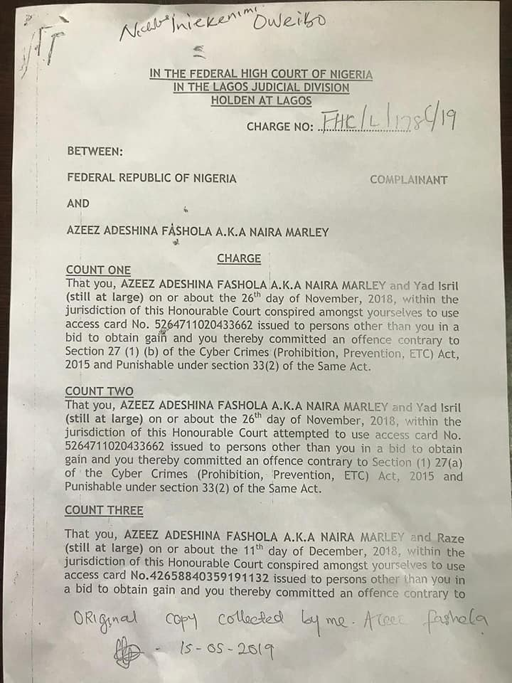 Naira Marley personally signs and collects his 'charge sheet' ahead of his arraignment in court on Monday. 3