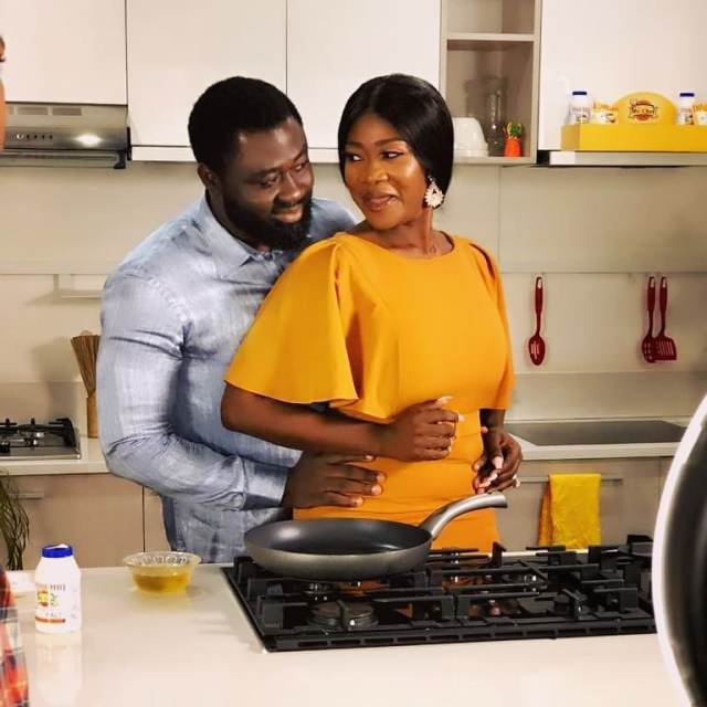 Mercy Johnson & her husband share a romantic moment kissing in the kitchen while cooking on her show (video)