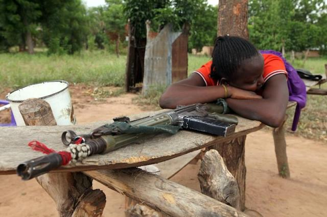 A woman lies on a riffle which she claims belong to her husband for self-defence